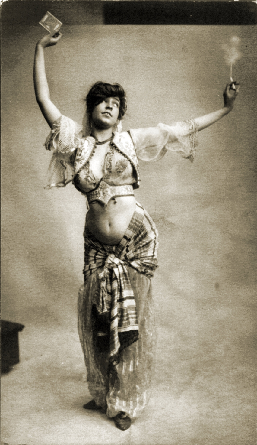 Woman in Belly-dancing Costume Smoking a Cigarette 1900
