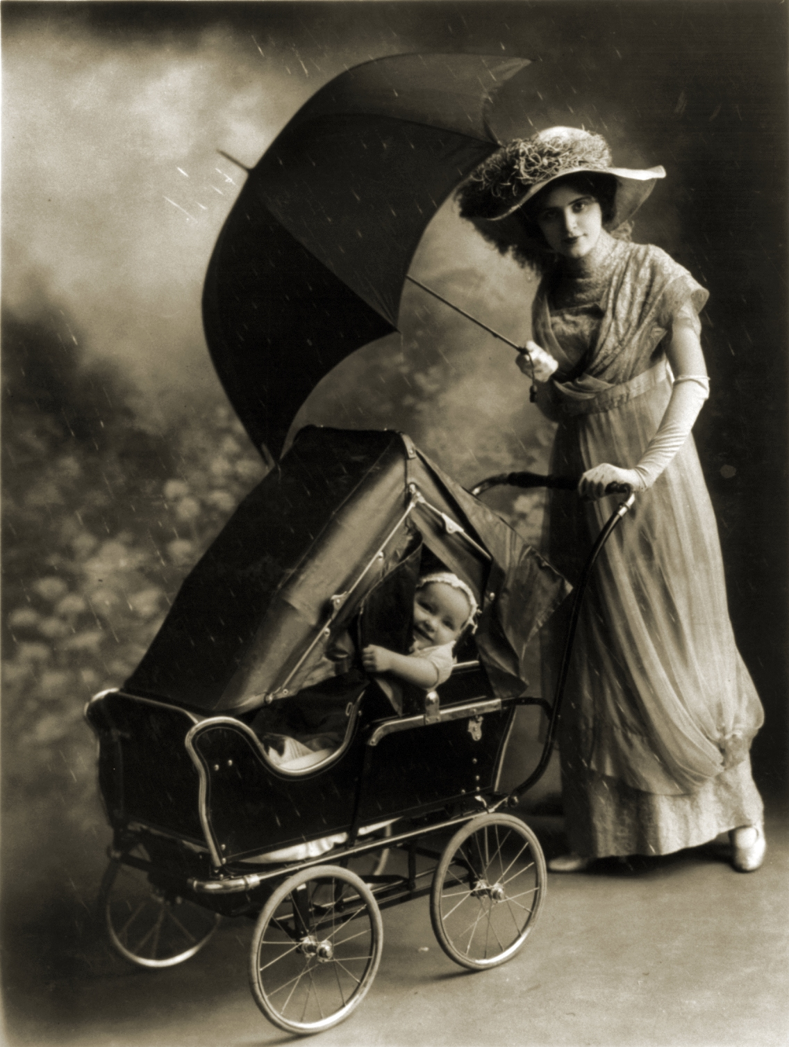 Woman Pushing a Baby Carriage 1913